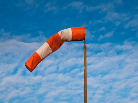 Wind Sock against Blue Sky with Fluffy Clouds Stock Photo - 17324773
