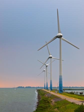 ijsselmeer: Wind Turbines on a pier at IJsselmeer in the Netherlands Stock Photo