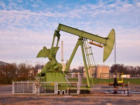 European Oil Pump Jack in Germany on a Sunny Day photo
