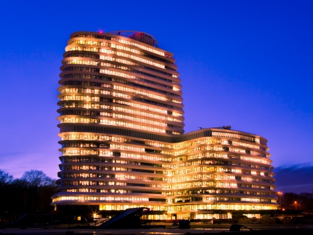 Long Working Hours in a Tall Modern Office Building with Lights during the Blue Hour
