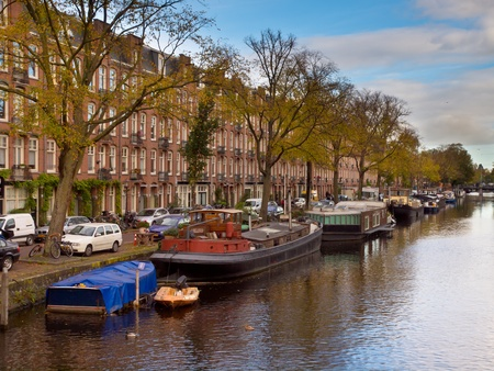 House boats in a Gracht Canal in Amsterdam in the Netherlands Stock Photo - 21950567