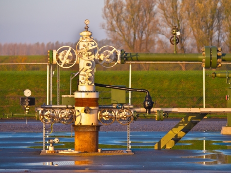 Vintage natural gas well head in Grijpskerk, Netherlands photo