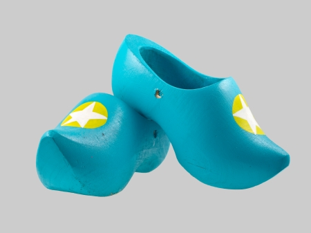 klompen: Funky Blue Traditional Wooden Shoes from the Netherlands on a Gray Background