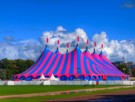 circus tent: Huge Big Top Circus Tent, Buit up for a Music Festival on a Sunny Day in the Park
