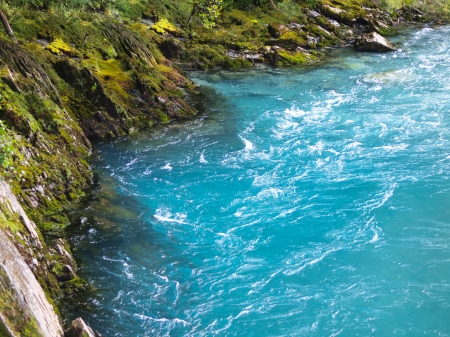 aspiring: Amazing Blue River Water at Mount Aspiring National Park, New Zealand