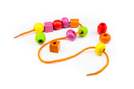 bead: Wooden Beads on a String making a Colorful Toy Necklace