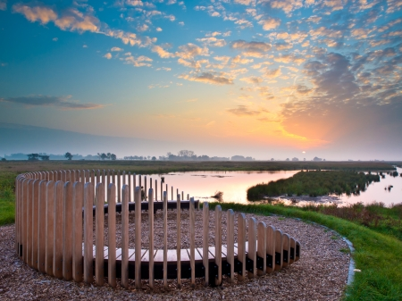 Wooden Lookout Bench overseeing Sunset over a Swamp Nature Reserve