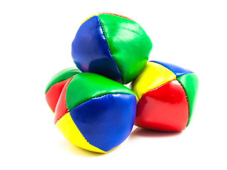 difficult lives: Concept for Multitasking Challenges, Stack of Colorful Juggling Balls on White Background Stock Photo