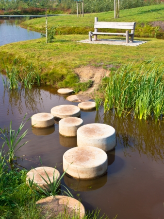 other side of: Stepping Stones in Water of a Pond