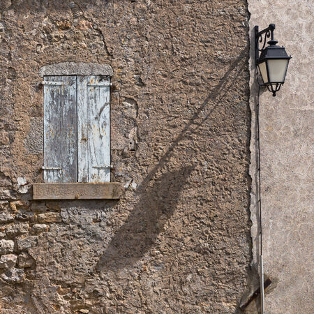window panes: Facade of an Old French House With Window Panes and Window Shutters Stock Photo