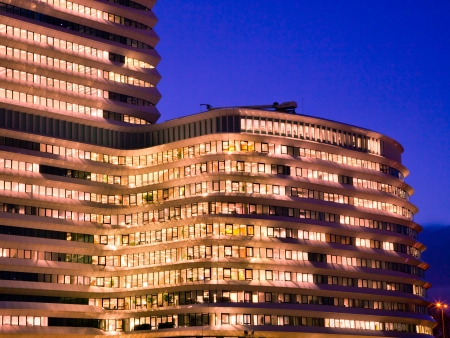 Long Working Hours in a Tall Modern Office Building with Lights during the Blue Hour photo