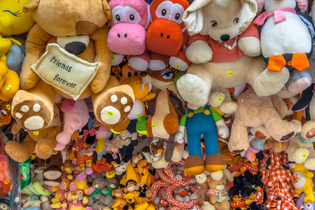 county fair: Teddy Bears and Cuddly Animal prizes in a Stall on a Fun Fair