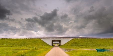 Tunnel leading to clouds as a metaphor for approaching problems photo