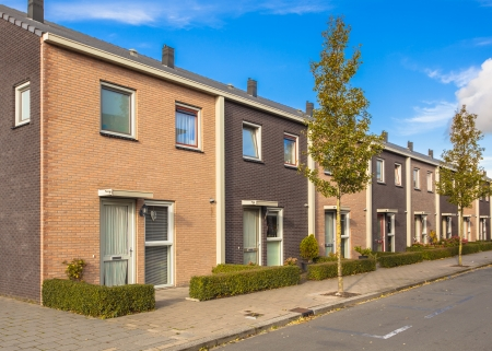 Modern Street with Terraced Houses in Suburban Neighborhood photo