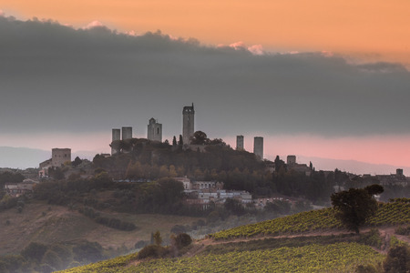 Towers of World Heritage Site Village San Gimignano on the top of a Hill during Sunrise, Italy