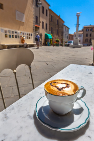 Having a Cup of Cappucino in an Italian Town photo