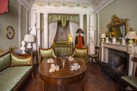 manor house: Ancient Bed Room in Yellow Colors in a Museam