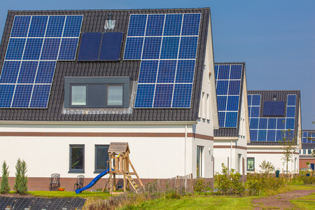 newly: Solar Panels installed on Newly Constructed Houses in a Suburban Area