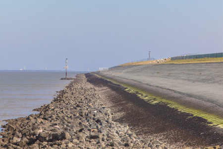 dike: Dike along the Sea in the Netherlands to Protect against Sea Level Rising Stock Photo
