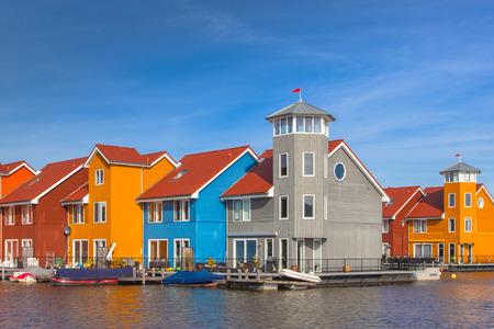 groningen: Waterfront houses in various colors in Groningen, Netherlands Editorial