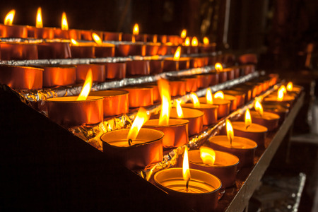 votive: Votive Candles in a Group burnt to pray for Someone Else Stock Photo