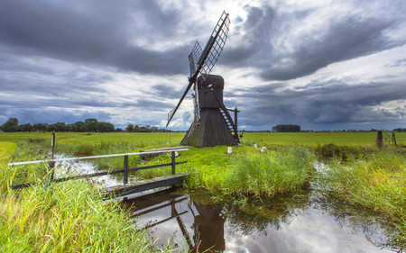 polder: Traditional Wooden Windmill to Pump out Water from a Polder near Leeuwarden, Friesland, Netherlands Stock Photo