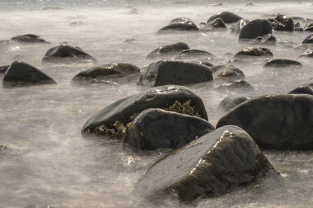 Long Exposure Image of Rocks in the Sea photo