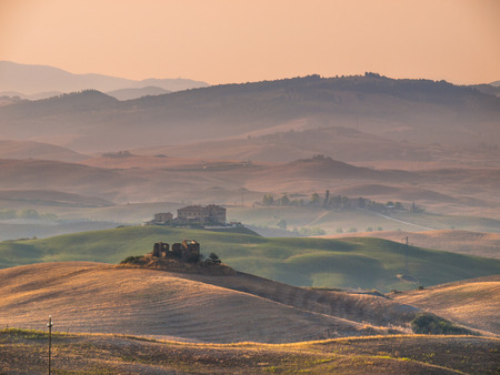 volterra: Sunrise over Farms in Hilly Countryside in Tuscany, Italy Stock Photo