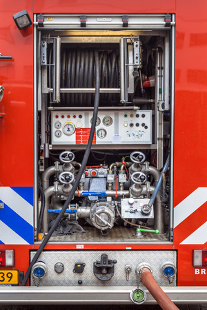 Hoses, Valves and other Inventory of a Fire Engine photo