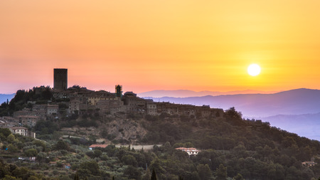 Sunrise over Tuscan Town of Montecatini in Val di Cecina near Volterra, Italy photo