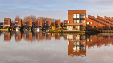 Modern water front houses in Leeuwarden Zuiderburen, the Netherlands photo