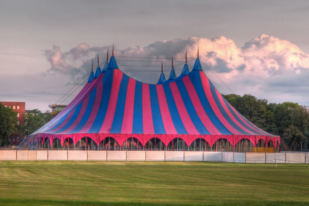 big top circus tent on grass in the park