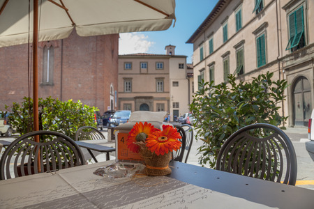 Terrace Table on the Street in Lucca, Tuscany, Italy photo
