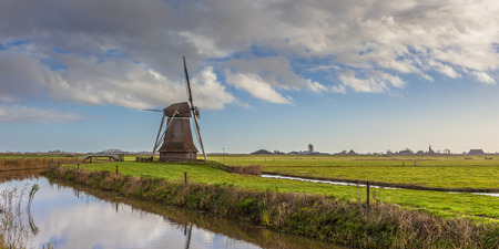 dutch windmill: Traditional wooden windmill in Frisian countryside, Netherlands