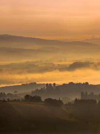 volterra: Tuscany Village Landscape near Florence on a Foggy Morning, Italy