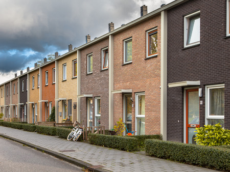 middle class: Middle Class Terraced Houses in Earthy Colors Stock Photo