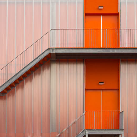 sports hall: Fire escape stairs on the outside of a modern sports hall