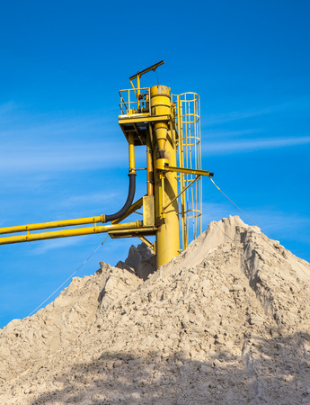gravel pit: Sand Hill at a Sand Mine with Blue Sky