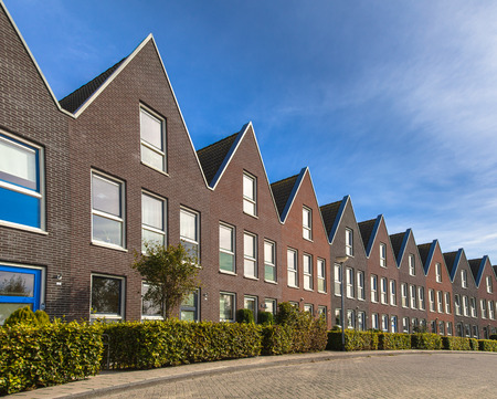 house sale: Modern Street with Terraced Real Estate for Families in the Netherlands Stock Photo