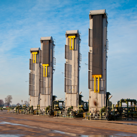 oilwell: European Modern Steam Injection Oil Pump Jack in the Heavy Crude Oil Tar Sand Fields of the Netherlands