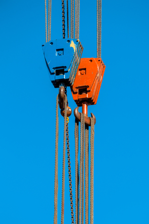 Blue and Red Crane Hook with Steel Cables photo