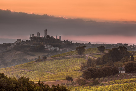 siena: Towers of Village San Gimignano on the top of a Hill during Sunrise, Italy