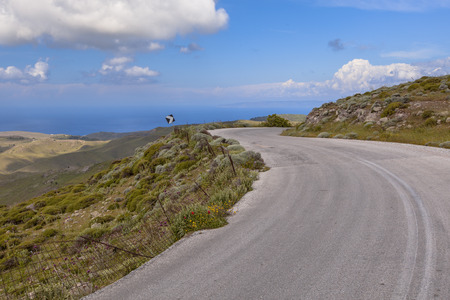 ramparts: Curved road through hilly Landscape with typical bush vegetation near Ypsilou Monastery on Lesbos island, Greece