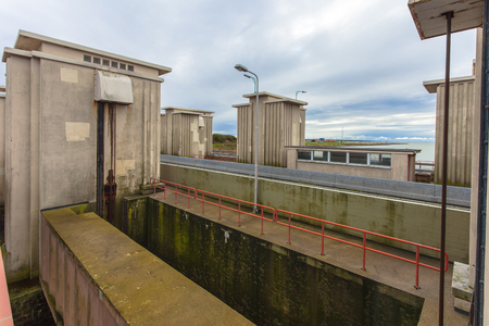 lift lock: Locking Chamber in Afsluitdijk as part of Dutch Delta Works Water Management Security System Stock Photo