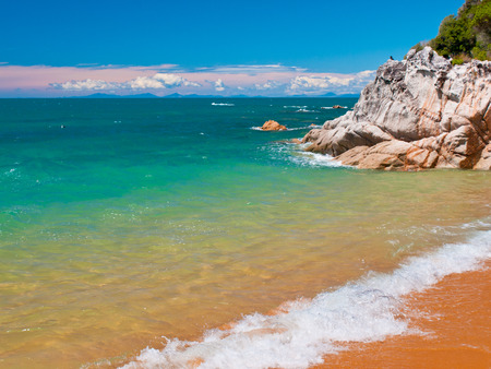 subtropics: Rocky Outcrop on a Tropical Beach with Turquoise Water in Abel Tasman National Park, New Zealand