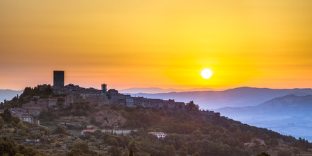 toscana: Sunrise over Tuscan Town of Montecatini in Val di Cecina near Volterra, Italy