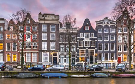 traditional culture: Traditional canal houses in many colors on Brouwersgracht in the grachtengordel the UNESCO World Heritage site of Amsterdam Editorial