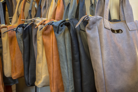vanity bag: Handmade leather shoulder bags on display in a shop Stock Photo