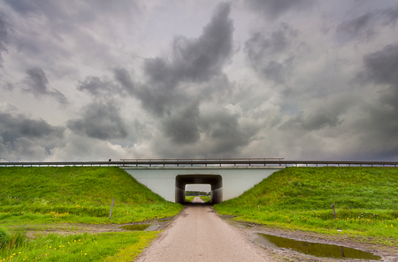 approaching: Tunnel leading to clouds as a metaphor for approaching a problematic period in life
