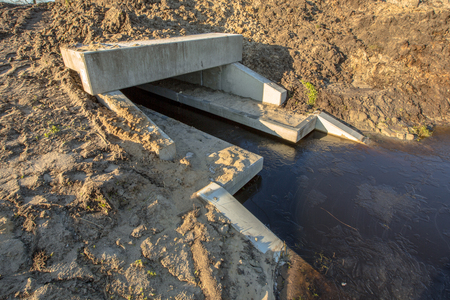 culvert: Eco Friendly Culvert under construction with walking strips for animals above the waterline serving as a wildlife crossing